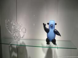 Reconstructed glass pitcher and a ceramic bear at Corning Museum of Glass.jpg