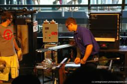 Glassmaker making glass at Corning Museum of Glass show.jpg